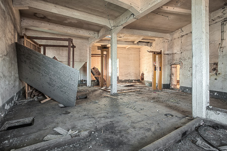 Destroyed room in an abandoned factory photo