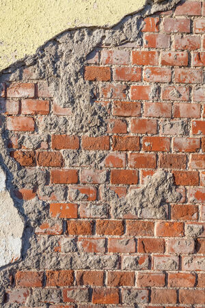revetment: Ruined wall of an old building with bricks Stock Photo