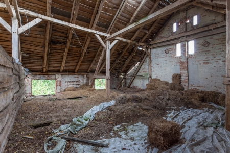 Old, built of wood and brick, abandoned barn