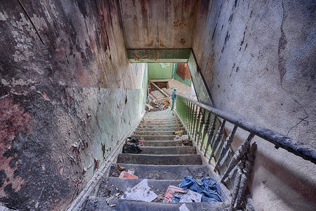 The interior of an abandoned house - stairs to the attic burned photo