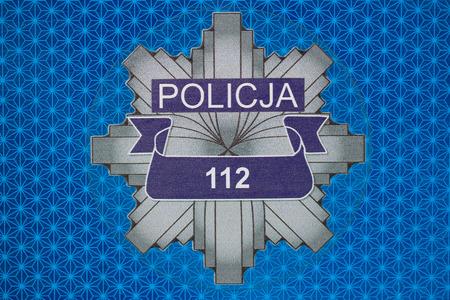 Symbol of Polish Police - reflective sticker on a police car