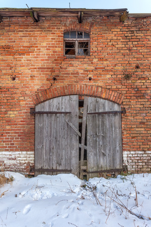 forgotten: Wooden gate to the old, forgotten barns Stock Photo