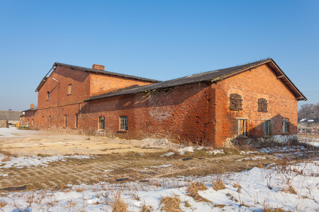 Old, abandoned and forgotten building of red brick photo