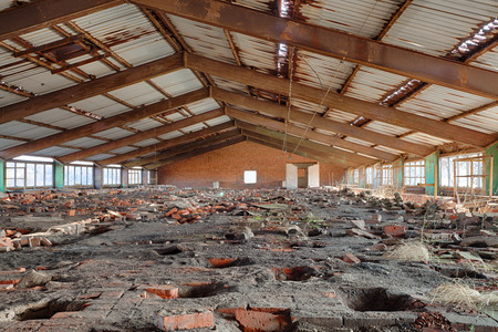 Interior of a ruined brick factory photo