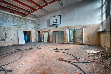 Forgotten gym in a ruined building photo