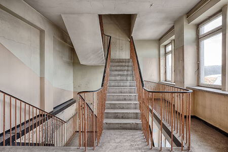 Forgotten staircase in a ruined building photo