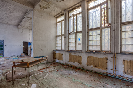 decaying: Destroyed interior with barred windows