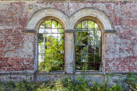 Damaged window of a ruined mansion Standard-Bild