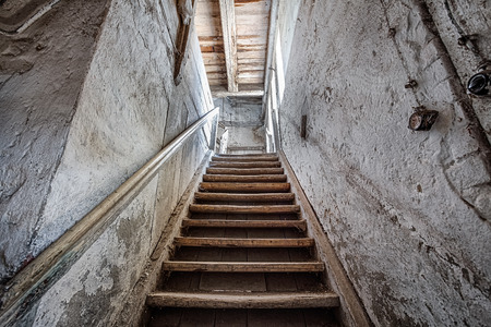 Old stairs inside a forgotten home Archivio Fotografico