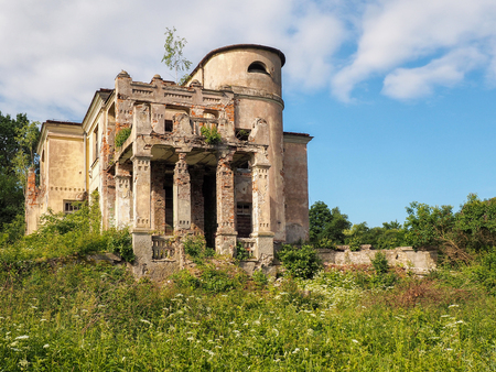 urban decline: Overgrown ruins of an old manor house Stock Photo