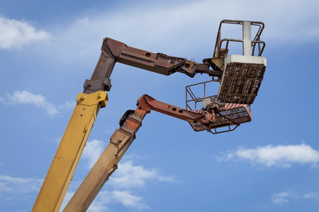 lifting jack: Two empty jacks on the sky background Stock Photo