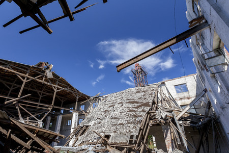 hurricane: Collapsed roof in an old factory Stock Photo