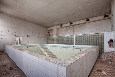 forgotten: Forgotten pool in an abandoned hospital Stock Photo