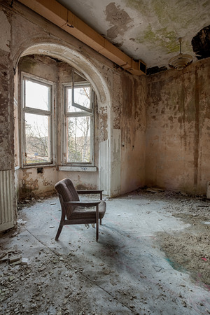 abandoned warehouse: Armchair in the middle of an abandoned warehouse