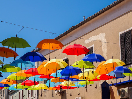 europe travel: Colorful umbrellas hanging over the alley of the old city