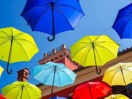rainbow umbrella: Colorful umbrellas hanging over the alley of the old city