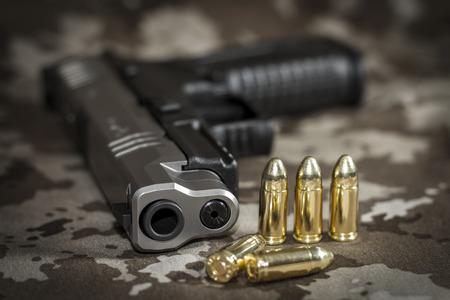 9mm ammo: Gun and cartridges - focus on the barrel