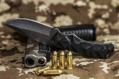 9mm ammo: Pistol, cartridges and a knife