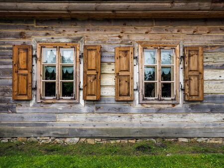 shingle: A windows with shutters in old, wooden house Stock Photo