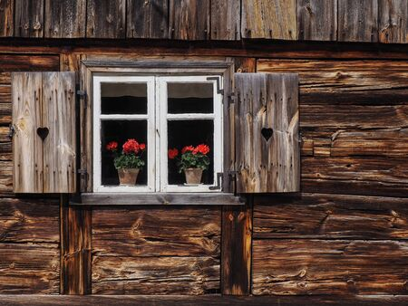 shingle: A window with shutters in old, wooden house