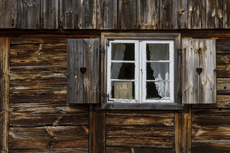 rungs: A window with shutters in old, wooden house