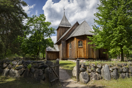 The old wooden church with stone wall Stock Photo