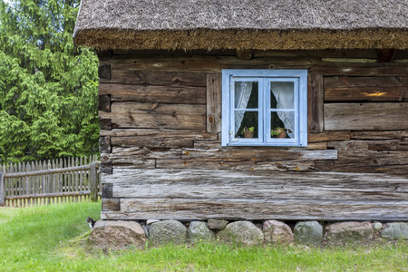 roof shingles: A window in old, wooden house