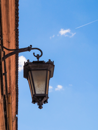 Old lantern on the wall of the building Banco de Imagens