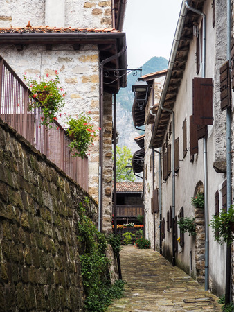 A narrow street in an old Italian city Banco de Imagens