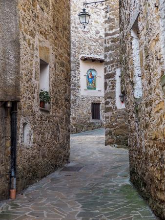 A narrow street in an old Italian city Banco de Imagens