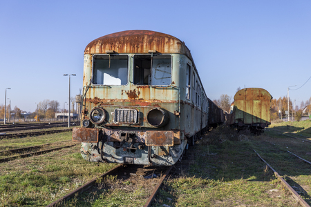 Abandoned diesel railbus  with cars