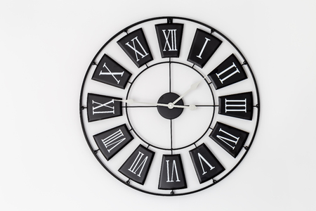 Black clock on a white wall Banco de Imagens