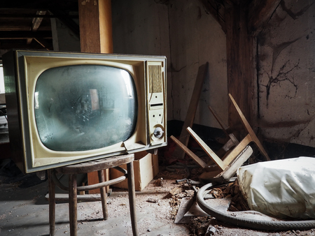 Old television set on an abandoned attic Banco de Imagens