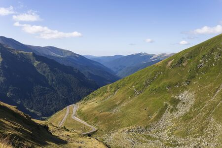 Mountain road crossing the southern section of the Carpathian Mountains of Romania Banco de Imagens