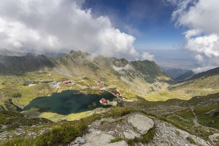 Glacier lake in the Fagaras Mountain and winding mountains road