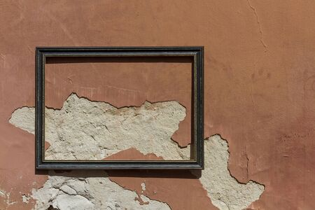 A decorated frame on an ugly wall Banco de Imagens