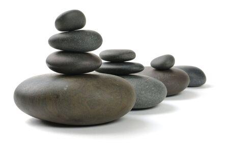 black pebbles: Zen stones on the white background
