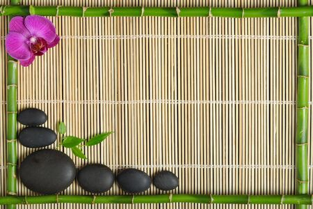 bamboo mat: Bamboo frame with orchid on the mat