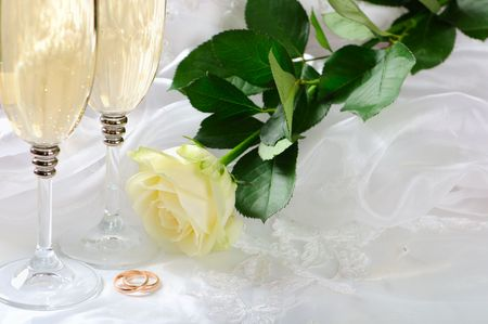 wineglass,rose and gold rings on the dress photo