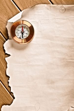 books on a wooden surface: old paper and compass Stock Photo