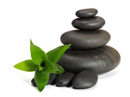 stacking: Zen stones and bamboo on the white background