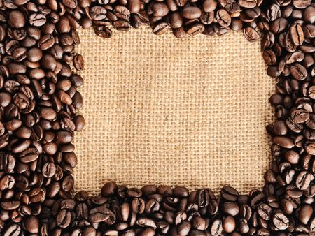 coffee beans border on the sack backgrond photo