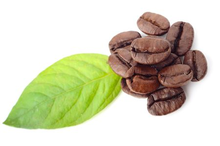 coffee beans and leaf on the white background Stock Photo - 7641307