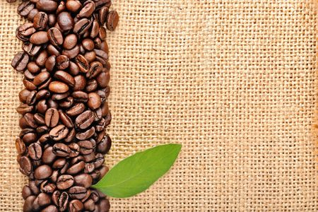 white cup with  coffee and coffee beans photo