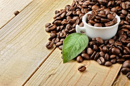 white cup with  coffee and coffee beans Stock Photo - 7826851