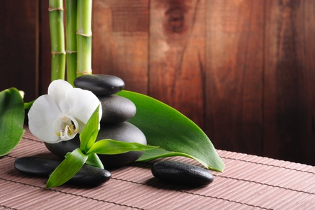 bamboo mat: spa concept zen basalt stones and  orchid Stock Photo