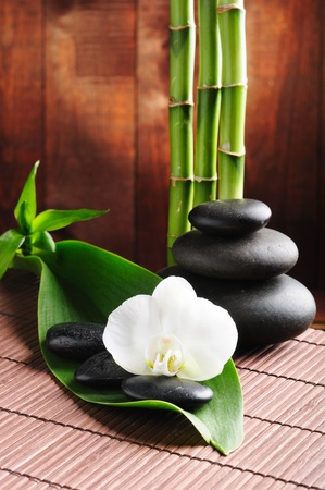 bamboo: spa concept zen basalt stones and  orchid Stock Photo