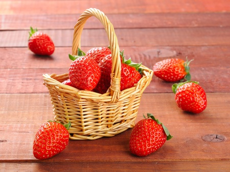 Beautiful strawberries in the bascet on the table photo