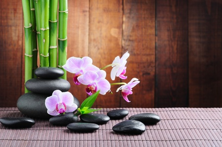 bamboo mat: spa concept with zen stones and  orchid