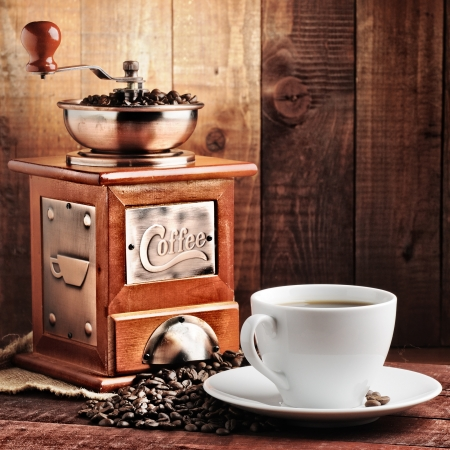 coffee beans and old coffee mill Stock Photo - 9408473